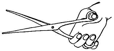 Рис. 8. Прием держания ножниц