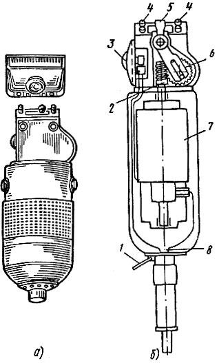 Рис. 21. Электрическая машинка для стрижки волос: а - общий вид, б - устройство; 1 - кольцо для подвески, 2 - червячная передача, 3 - выключатель, 4 - крепления для сменных головок, 5 - рычаг для подвижных пластин головки, 6 - шестеренка, 7 - электродвигатель, 8 - кабель включения